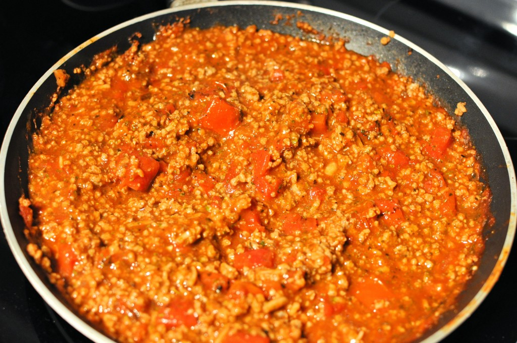 stir together ground beef diced tomatoes tomato soup and seasoning